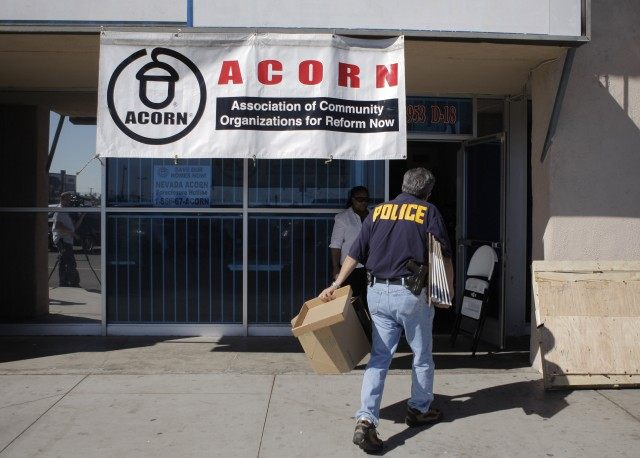 An investigator enters the ACORN office in Las Vegas, Tuesday, Oct. 7, 2008. A Nevada secretary of state's office spokesman said Tuesday that investigators are looking for evidence of voter fraud at the office.(AP Photo/Jae C. Hong)