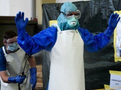 ebola-worker-hose-down-reuters