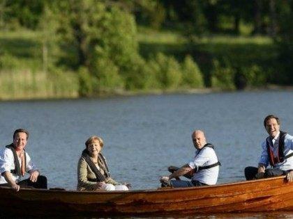 Cameron-Merkel-Boat_AFP