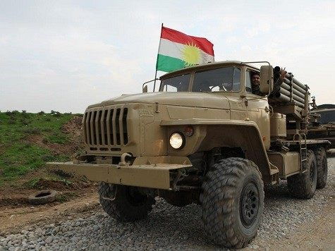Kurdish fighters celebrate advancing on the Islamic State. AP Photo/Zana Ahmed