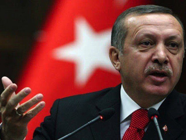 "Turkish Prime Minister Recep Tayyip Erdogan addresses lawmakers at the parliament in Ankara, Turkey, Tuesday, March 22, 2011. Erdogan said that he has concerns about possible NATO military action in Libya, but he has not flatly opposed such a mission. ""Turkey will not point arms at the Libyan people,"" he …"