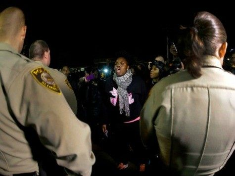 ferguson-protestors-and-cops-ap