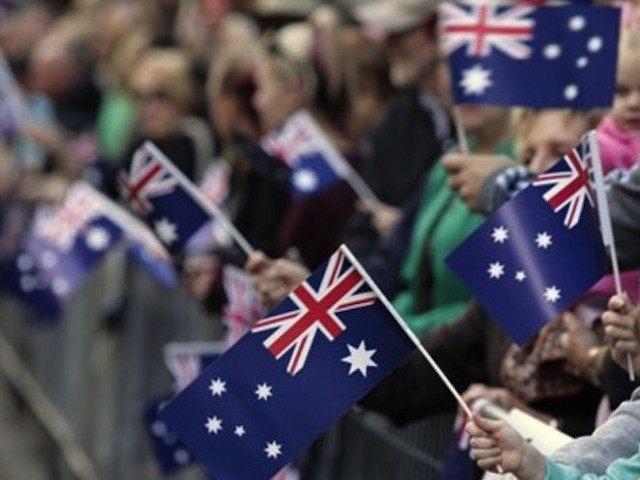 Girl holds Australian Flag at Parade