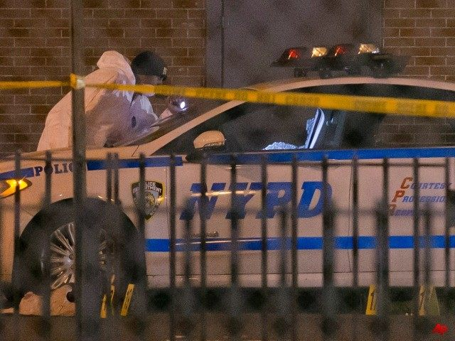 Investigators work at the scene where two NYPD officers were shot, Saturday, Dec. 20, 2014 in the Bedford-Stuyvesant neighborhood of the Brooklyn borough of New York. Police said an armed man walked up to two officers sitting inside the patrol car and opened fire before running into a nearby subway …