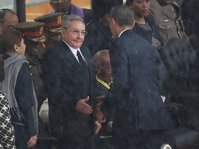 Raul Castro and Barack Obama greet at Mandela funeral in 2013 (AP)