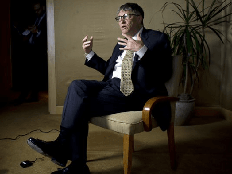 Bill-Gates-seated-talking-AFP
