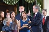 Texas Attorney General Ken Paxton takes the oath of office from outgoing AG Greg Abbott.
