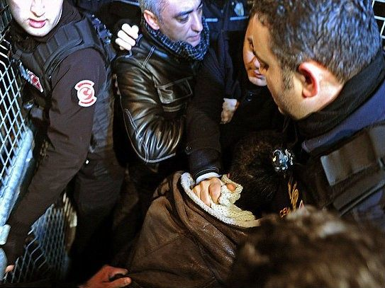 One demonstrator is detained (AFP/Getty)