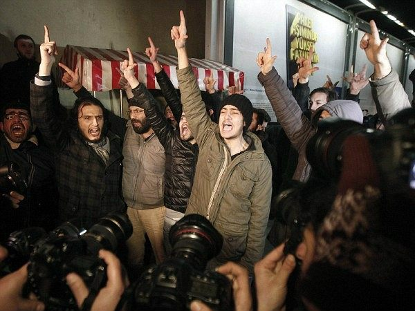 Demonstrators in Istanbul denounced newspaper Cumhuriyet for printing a four-page spread of Charlie Hebdo cartoons (Reuters)