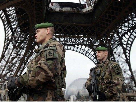 Thpusands of police and soldiers flood Paris streets. Credit: Reuters
