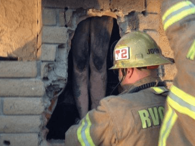 Woman Freed from Fireplace (Engineer Jared Hazelaar / Cal Fire Riverside)