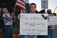 A man protests an Islamic Rally in Houston.
