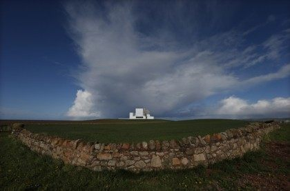 A dry stone wall surrounds a field outside Torness Power Station in Dunbar, Scotland