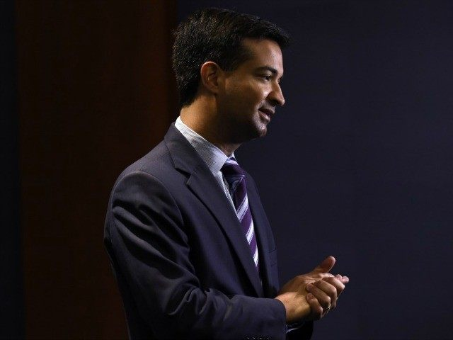 Rep.-elect Carlos Curbelo, R-Fla., does a television interview before the start of a new member orientation on Capitol Hill in Washington, Thursday, Nov. 13, 2014. Newly-elected representatives will participate in a week-long orientation session for House freshmen. (AP Photo/Susan Walsh)