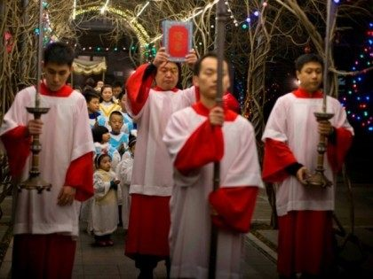 Children prepare to take part in a mass on the eve of Christmas at the South Cathedral official Catholic church in Beijing, China, Wednesday, Dec. 24, 2014. Estimates for the number of Christians in China range from the conservative official figure of 23 million to as many as 100 million …