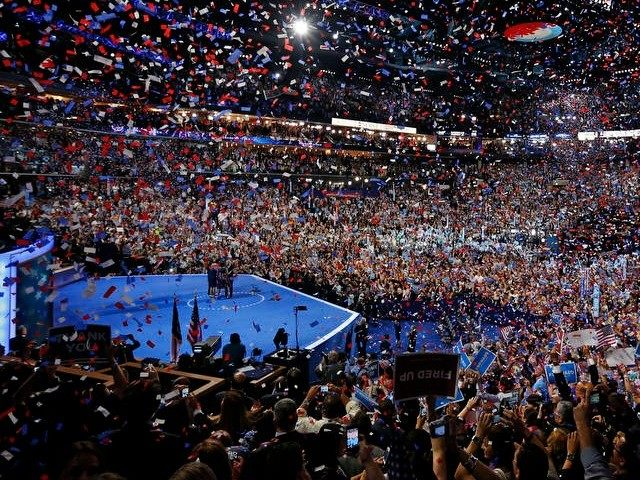 President Barack Obama and his family and Vice President Joe Biden and his family celebrate their nominations as the confetti falls at the conclusion of the Democratic National Convention in Charlotte, N.C., on Thursday, Sept. 6, 2012.