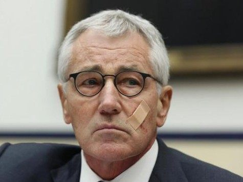 U.S. Secretary of Defense Chuck Hagel listens during his testimony at the House Armed Services Committee on Capitol Hill in Washington