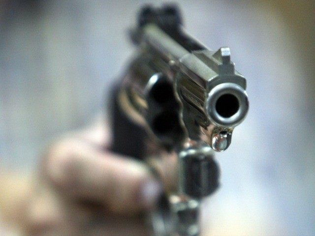 An employee at John Jovino Co. holds a revolver on Thursday, June 26, 2008 in New York. The U.S. Supreme Court ruled earlier in the day that Americans have a constitutional right to keep guns in their homes for self-defense - the justices' first major pronouncement on gun control in …