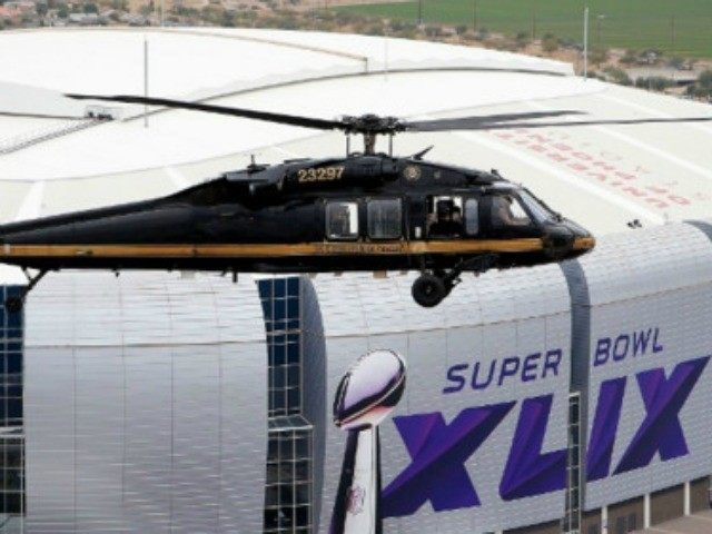 With the Phoenix skyline in the background, a U.S. Customs and Border Protection Black Hawk helicopter flies above University of Phoenix Stadium, site of the NFL Super Bowl XLIX football game, during a security demonstration for the media on Jan. 26.