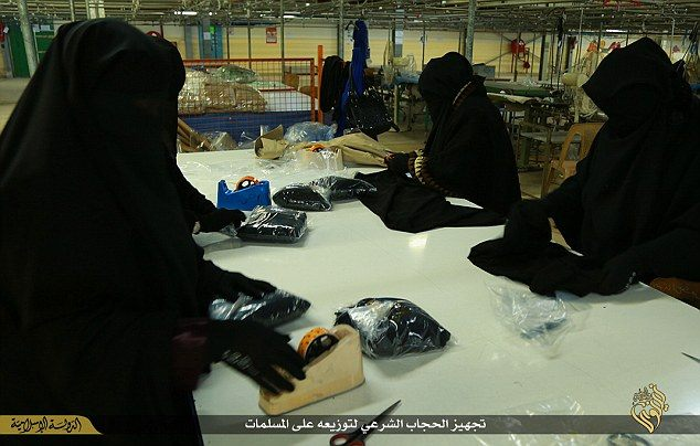 Women working to pack new hijabs.