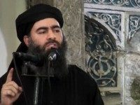 This file image made from video posted on a militant website Saturday, July 5, 2014, which has been authenticated based on its contents and other AP reporting, purports to show the leader of the Islamic State group, Abu Bakr al-Baghdadi, delivering a sermon at a mosque in Iraq during his first public appearance.