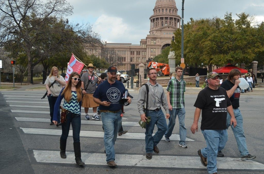 Members of Open Carry Texas march from the Texas Capitol down Congress Avenue while legally carrying rifles and antique pistols.