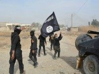 "Iraqi government forces celebrate while holding an al-Qaeda affiliated flag after they claimed they have gained complete control of the Diyala province, northeast of Baghdad, on January 26, 2015 near the town of Muqdadiyah. Iraqi forces have ""liberated"" Diyala province from the Islamic State jihadist group, retaking all populated areas …"