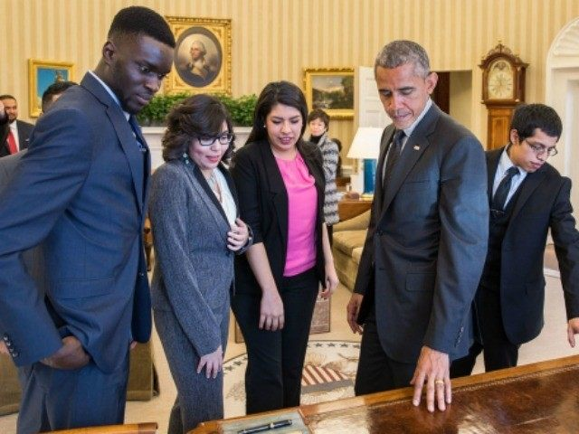 President Barack Obama shows the Resolute Desk to a group of DREAMers, following their Oval Office meeting in which they talked about how they have benefited from the Deferred Action for Childhood Arrivals (DACA) program, Feb. 4, 2015.