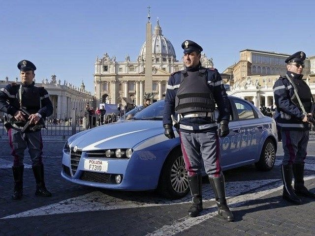 Italian policemen patrol in front of Saint Peter's Square in Rome