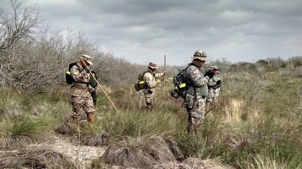Texas State Guardsmen searching for deceased immigrants in Brooks County. Photo by Gil Estrada.