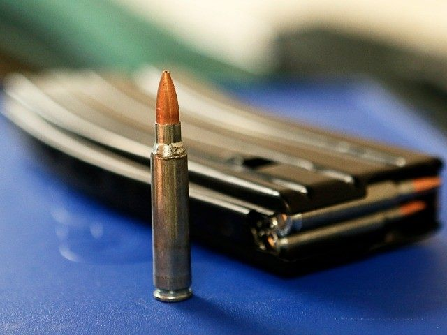 "UNITED STATES, Salt Lake City : SALT LAKE CITY, UT - JANUARY 15: Ammo and a high capacity 30 round clip sits on the table at the ""Get Some Guns & Ammo"" shooting range on January 15, 2013 in Salt Lake City, Utah. Lawmakers are calling for tougher gun legislation …"
