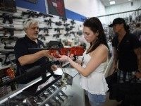 As the U.S. Senate takes up gun legislation in Washington, DC , Dr. Gary Lampert (L), a co-owner of the National Armory gun store, helps Cristiana Verro consider fire arms on April 11, 2013 in Pompano Beach, Florida.