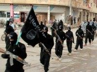 This undated file image posted on a militant website on Tuesday, Jan. 14, 2014 shows fighters from the al-Qaida-linked Islamic State of Iraq and the Levant (ISIL) marching in Raqqa, Syria. Saudi Arabia and other Gulf petro-powerhouses encouraged a flow of cash to Sunni rebels in Syria for years. But …