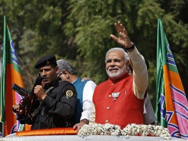 Modi, prime ministerial candidate for India's main opposition BJP, waves to his supporters in Vadodara