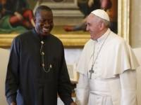 Pope Francis talks with Nigerian President Goodluck Jonathan during a private audience at the Vatican