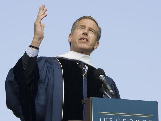 NBC News anchor Brian Williams delivers remarks after receiving an honorary doctorate in humane letters during commencement ceremonies from George Washington University on the National Mall