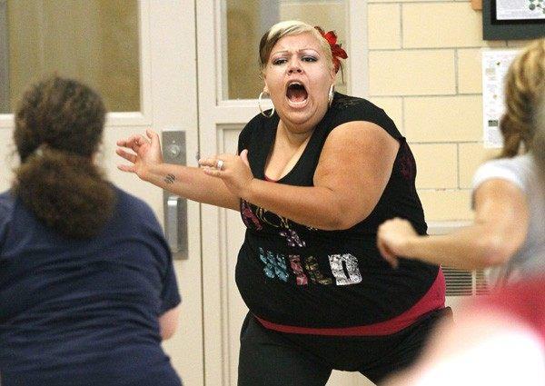 Maria Jose Delgado helps lead a Zumba exercise class in a low-income neighborhood of Denver