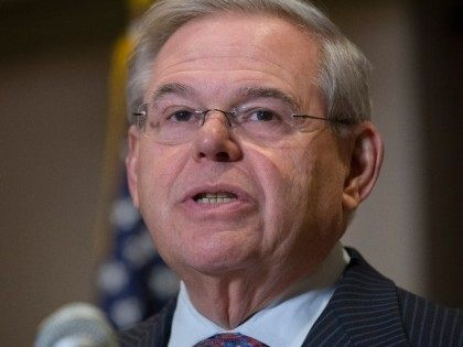 Sen. Bob Menendez, D-N.J., speaks to reporters during a news conference in Newark, N.J. on Friday, March 6, 2015. A person familiar with a federal investigation says the Justice Department is expected to bring criminal charges against the New Jersey Democrat in the coming weeks. Menendez says that he has …