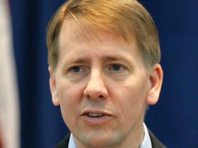 This Jan. 8, 2009 file photo shows Ohio's Attorney General Richard Cordray during his swearing-in ceremony in Columbus, Ohio.