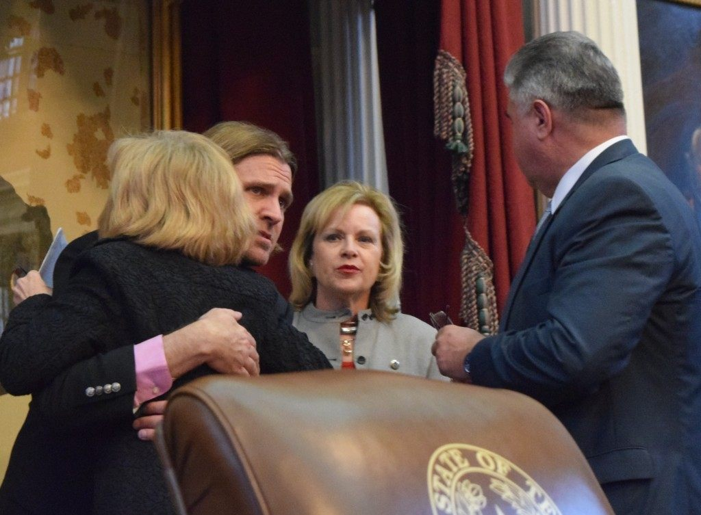 State Rep Debbie Riddle consoles Dan Golvach, father of Spencer Golvach who was murdered by an illegal alien on a random shooting spree.