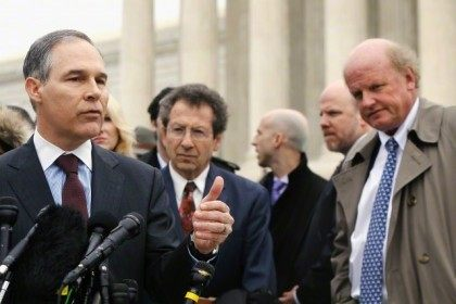Attorney General of Oklahoma Pruitt, a critic of the U.S. government in the King v. Burwell case, speaks to reporters after arguments at the Supreme Court building in Washington