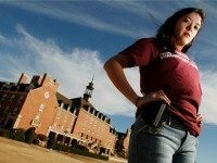 In this photo taken Tuesday, March 1, 2011, Adrienne O'Reilly, Oklahoma Director for Students for Concealed Carry on Campus, carries an empty gun holster on the Oklahoma State University campus in Stillwater, Okla. Some Oklahoma college students will be wearing empty gun holsters to show support for proposed legislation that would allow concealed weapons to be carried on school grounds.