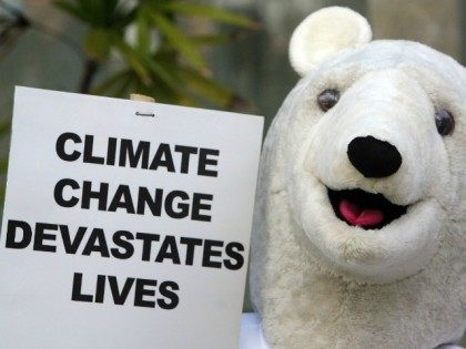 "An activist dressed as a ""Polar bear"" displays a placard during a demonstration at the venue of the UN Climate Change Conference 2007 in Nusa Dua, on Bali island, 06 December 2007. About a dozen of environmental activists dressed up as polar bears took part in the demonstration to allure …"