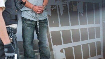 illegal immigrant in jail - AP Photo