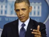 obama-gun-point-AP