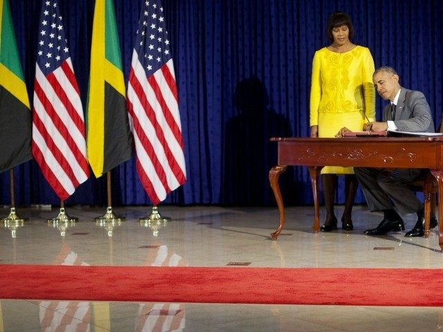 President Barack Obama , accompanied by Jamaican Prime Minister Portia Simpson-Miller, signs the guest book prior to their bilateral meeting at the Jamaica House, April 9, 2015, in Kingston, Jamaica.