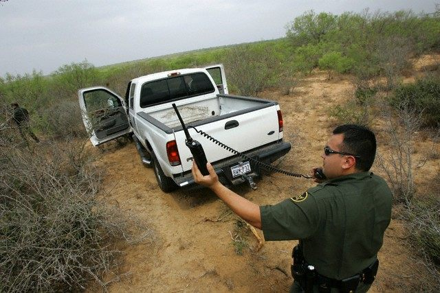 Border Patrol agent stands by stolen truck outside Laredo Texas