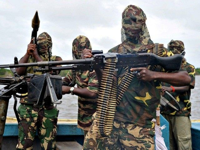 Boko Haram members poised with guns, ammunition, camouflage, masks