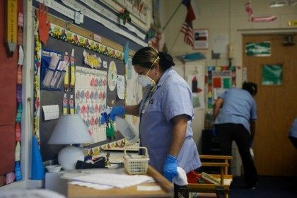 Workers disinfect classroom inside Canyon Creek Elementary School in Texas