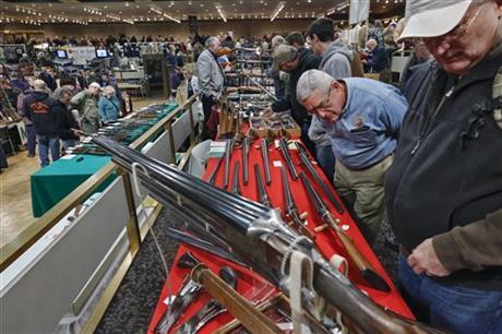 Gun Show AP Photo Philip Kamrass